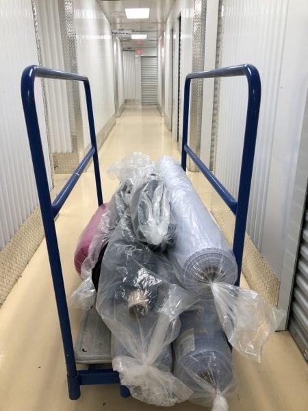 Unloading rolls of fabric