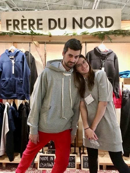 Duey and Milena of Frere du Nord, Duey is on the left wearing a grey hoodie and red pants, Milena is on the right in a grey tunic.