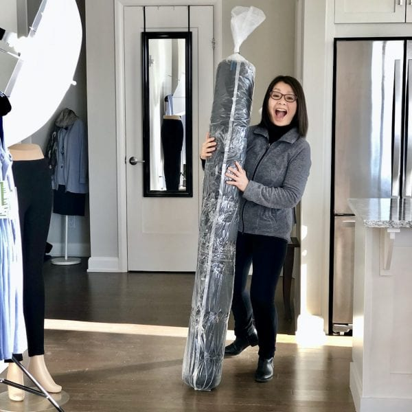 Colleen holding a big roll of bamboo fabric