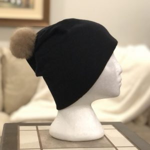 Black bamboo toque with a medium mink pompom on a mannequin head