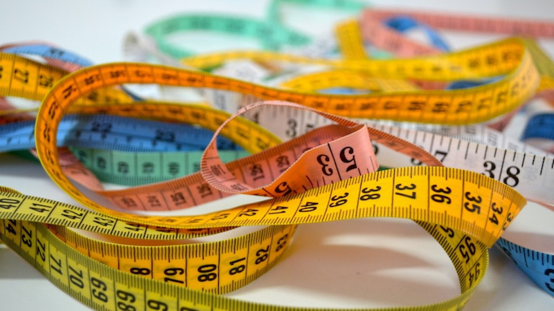 Can I ask you a favour? Can you measure your head? by Colleen Kanna, Photo of tape measures by Patricia Serna on Unsplash