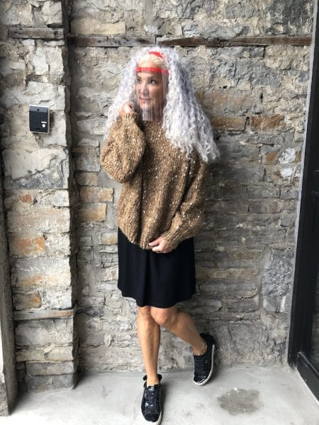 Mandy in the midnight black Carolyn with a chunky sweater overtop and black patent sneakers