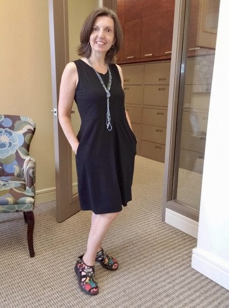 How to wear the Carolyn bamboo dress, Raquel is in the midnight black Carolyn with funky sandals and beaded necklace