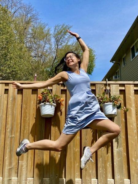 Amanda jumping for joy in the Silky Blue Carolyn Bamboo dress