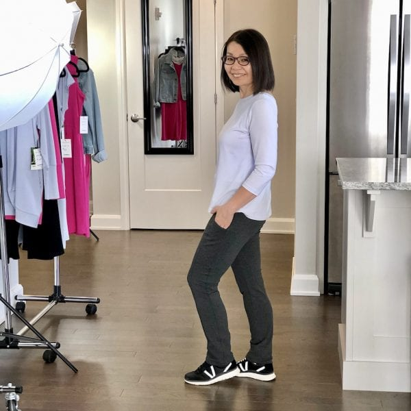 Would you like to be a Kanbassador/tester for COKANNA? by Colleen Kanna, Colleen is wearing the charcoal grey phone pocket pant with a 3/4 sleeve white shirt and black sneakers