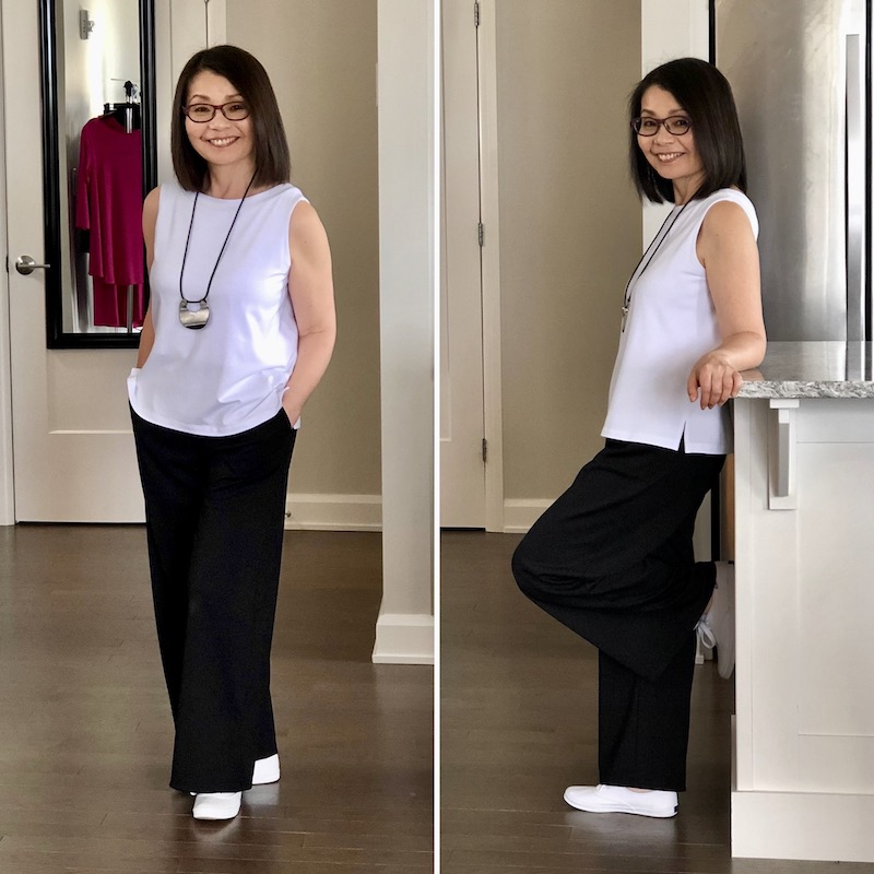 White bamboo tank with wide leg black pants and white sneakers.