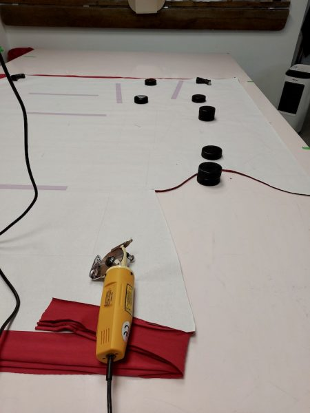 Finding ways to create less waste by Colleen Kanna, Photo of cutting table