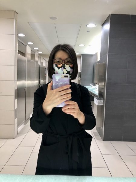 How did my travel capsule wardrobe work out? by Colleen Kanna, Selfie at airport of airplane travel outfit